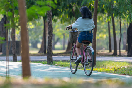 Bangkok, Thailand - March 15, 2017 : Unidentified people riding a bicycle by cycling on a bicycle lane in a outdoor park for exercise healthy Editorial