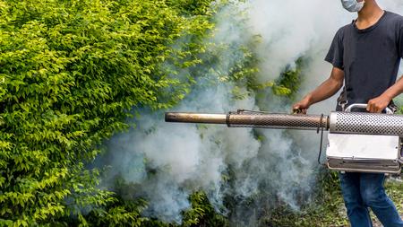 aedes: People fogging DDT spray kill mosquito for control Malaria, Encephalitis, Dengue and Zika in village at Bangkok Thailand. Stock Photo