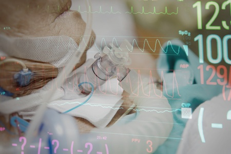 Patient asian elder women 80s do tracheostomy use ventilator for breathing help on bed in the hospital overlap with monitor display graph for pulse of heart rate and blood pressure.