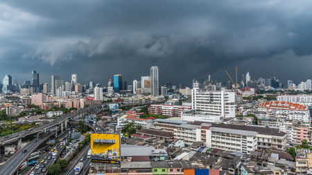 Bangkok, Thailand - May 8, 2017 : Cityscape and building of city in storm clouds sky from skyscraper of Bangkok. Bangkok is the capital and the most populous city of Thailand. Editorial