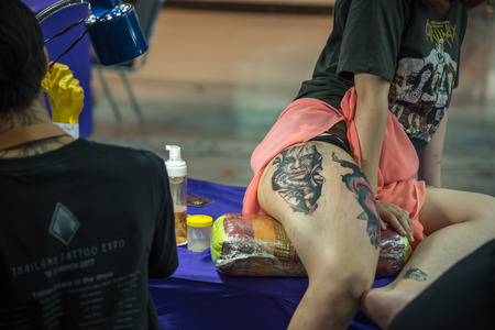 PathumThani, Thailand - May 6, 2017 : Unidentified professional tattoo artist drawing art on body at Body Art Tattoo Challenge 2017 Zeer Rangsit. This a open event no need press credentials required. Editorial