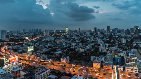 Bangkok, Thailand - May 11, 2017 : Cityscape and light of night road with billboard from skyscraper of Bangkok. Bangkok is the capital and the most populous city of Thailand. Editorial