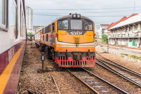 Bangkok, Thailand - July 12, 2017 : Unidentified railway train on the railroad tracks in Bangkok station. Many people in Thailand popular travel by train because it is cheaper.