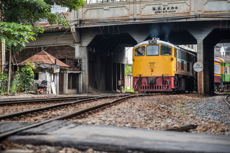 freight train: Bangkok, Thailand - July 12, 2017 : Unidentified railway train on the railroad tracks in Bangkok station. Many people in Thailand popular travel by train because it is cheaper.