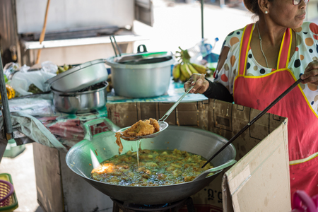 sesame street: Bangkok, Thailand - July 23, 2017 : Unidentified chef cooking a Thai dessert desame balls (Kanom Kai Hong) for sale at Thai street food market