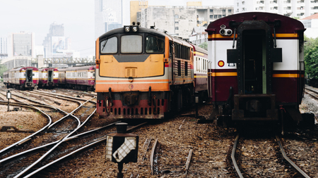 freight train: Railway train on the railroad tracks in Bangkok station. Many people in Thailand popular travel by train because it is cheaper. Editorial