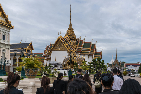 Thai mourners wearing black color waiting in The Grand Palace to pay tribute and respect to their beloved Rama 9 Thai King Bhumibol Adulyadej