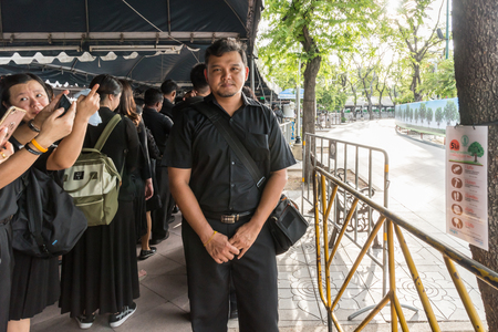 Bangkok, Thailand - August 25, 2017 : Unidentified Thai mourners wearing black color waiting in The Grand Palace to pay tribute and respect to their beloved Rama 9 Thai King Bhumibol Adulyadej