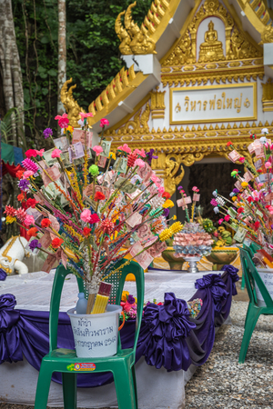 Chanthaburi, Thailand - July 8, 2017 : Unidentified Thai buddhism people in buddhist pray by Kathin Ceremony to make and off-season offering of robes and other needs to monks at Thai temple (Wat Thai) Editorial