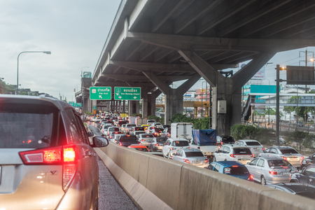 Bangkok, Thailand - July 4, 2017 : Cars on busy road in the Bangkok city, Thailand. Many cars use the street for transportation in rushhour with a traffic jam