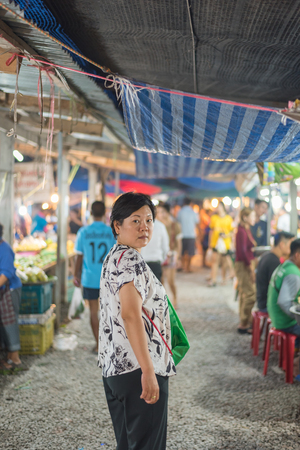 Bangkok, Thailand - June 17, 2017 : Unidentified woman shopping at Thai street food market vintage style can buy food vegetable and fruit in cheap price.