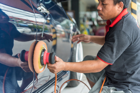 Bangkok, Thailand - November 11, 2017 : Unidentified car care staff cleaning the car (Car detailing). Editorial