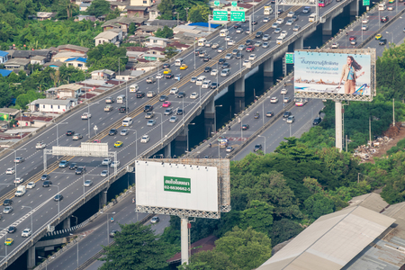 Bangkok, Thailand - August 28, 2016 : Cityscape and transportation with expressway and traffic in daytime from skyscraper of Bangkok. Bangkok is the capital and the most populous city of Thailand.
