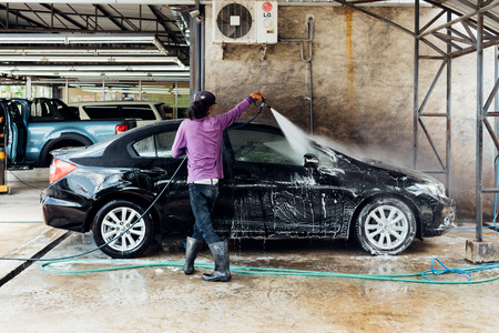 Bangkok, Thailand - June 23, 2017 : Unidentified car care staff cleaning the car (Car detailing).
