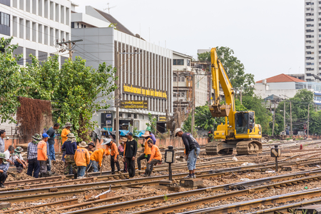 Bangkok, Thailand - August 11, 2016 : Unidentified railway employees working for restoration the railroad tracks in Bangkok station before serving at State Railway of Thailand.