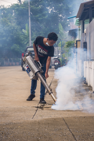 Bangkok, Thailand - July 3, 2016 : Unidentified people fogging DDT spray for mosquito kill and protect by control mosquito is a carrier of Malaria, Encephalitis, Dengue and Zika virus in village. 新聞圖片