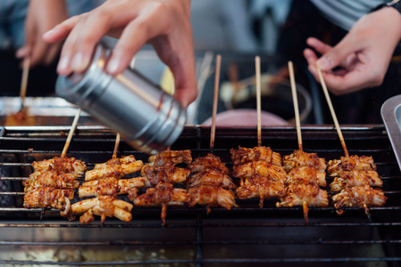 Mala is Grilled meat (Beef, Pork, Chickens or Mushroom) with chilli sauce and chinese hot spicy herb (Sichuan Pepper) for sale at Thai street food market or restaurant in Bangkok Thailand