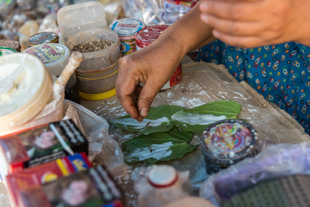 Payathonzu, Myanmar - March 2, 2018 : Make chewing gum culture in market at Payathonsu in the south of Kayin State, Culture chewing betel nut or in Burmese called Gwyn, Myanmar
