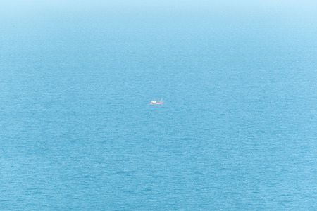 Fishing boat is out fishing in blue sea or ocean for fishing industry by fishermen