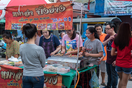 Ang Thong, Thailand - August 11, 2018 : Unidentified chef cooking a Mala is Grilled meat (Beef, Pork, Chickens or Mushroom) with chilli sauce and chinese hot spicy herb (Sichuan Pepper) for sale
