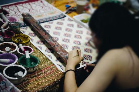 Thai artist drawing a striped Thai art for making Thai silk design by Ayutthaya traditional contemporary fashion Stock Photo