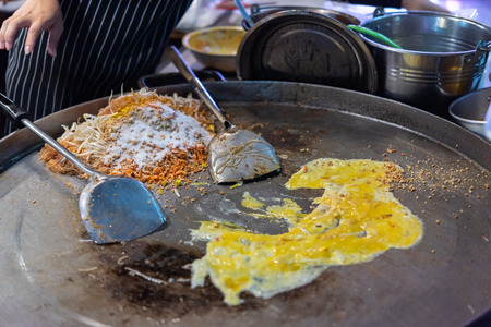 Fried noodle Thai style (Pad Thai) for sale at Thai street food market or restaurant in Thailand