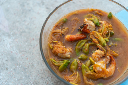 Hot and Sour Katuri Flower Soup for sale at Thai street food market or restaurant in Thailand Stock Photo