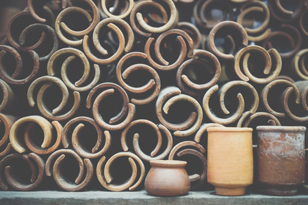 Earthenware make from soil and clay (terracotta) is asian vintage craft in asia for make pot, bowl and other container Stock Photo