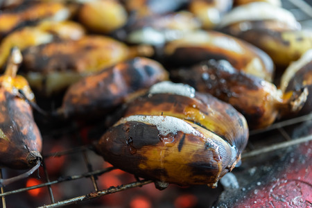 Roasted or Grilled Banana for sale at Thai street food market or restaurant in Thailand