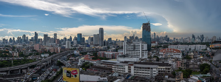 Bangkok, Thailand - May 25, 2018 : Panorama cityscape and transportation with expressway traffic in daytime from skyscraper of Bangkok. Bangkok is the capital and the most populous city of Thailand.