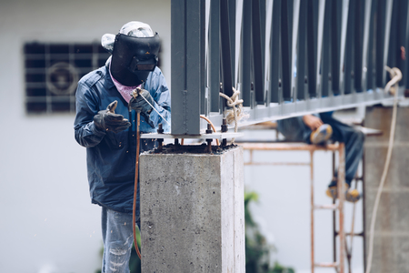 Construction worker or professional work for building a builder at construction site.