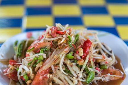Papaya salad or Papaya Pok Pok (Som tum) for sale at Thai street food market or restaurant in Thailand
