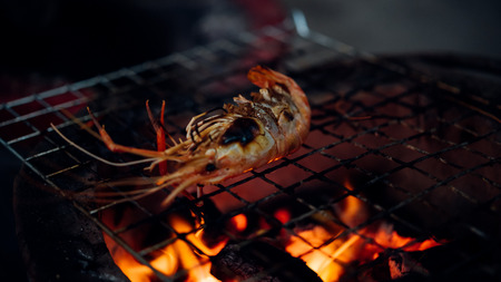 Grilled shrimp (Giant freshwater prawn) grilling with charcoal for sale at Thai street food market or restaurant in Bangkok Thailand Stock Photo