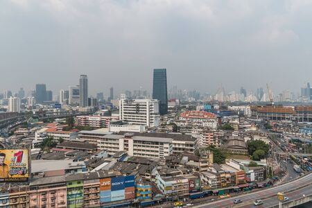 Bangkok, Thailand - January 31, 2019 : Cityscape of Bangkok city with smog PM2.5 dust exceed the standard value of Bangkok city with bad weather air pollution cause poor visibility and health hazards Editöryel