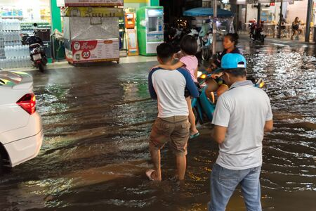 Bangkok, Thailand - October 2, 2018 : Water flood in Bangkok city problem with the manhole overflow in drainage system it full from garbage when rain storm. Editorial
