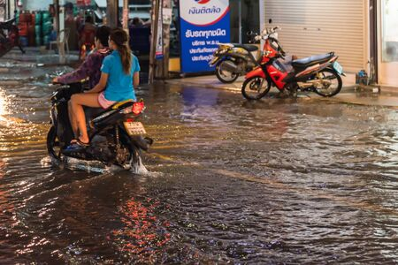 Bangkok, Thailand - October 2, 2018 : Water flood in Bangkok city problem with the manhole overflow in drainage system it full from garbage when rain storm. Editöryel