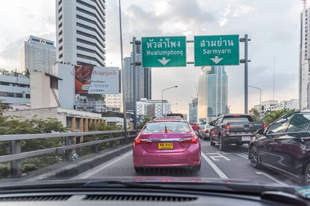 Bangkok, Thailand - October 4, 2018 : Cars on busy road in the Bangkok city, Thailand. Many cars use the street for transportation in rush hour with a traffic jam