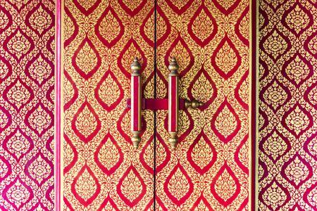 Ang Thong, Thailand - June 25, 2017 : Phra ubosot door with Thai art in buddhist temple at Wat Lo Sutthawat, Buddhist temple in Tambon Sala Daeng, Mueang Ang Thong District, Ang Thong Editöryel