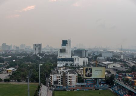 Bangkok, Thailand - January 31, 2019 : Cityscape of Bangkok city with smog PM2.5 dust exceed the standard value of Bangkok city with bad weather air pollution cause poor visibility and health hazards Editorial