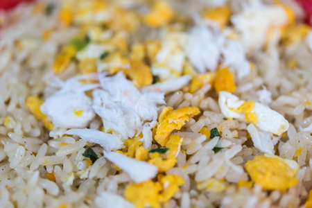 Crab meat fried rice is seafood for sale at Thai street food market or restaurant in Bangkok Thailand