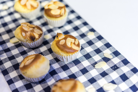 Cupcake or Sponge Cake is a cake based on flour , sugar, butter and eggs, and is sometimes leavened with baking powder topped with almond at Thai street food market or bakery dessert restaurant 写真素材