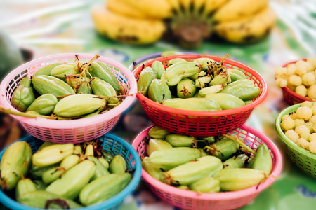 Bilimbi (Bilimbing or Cucumber Tree) and Phyllanthus acidus and Banana is Thai exotic vegetables in market exotic vegetables can buy at Thai street food and vegetables stall market