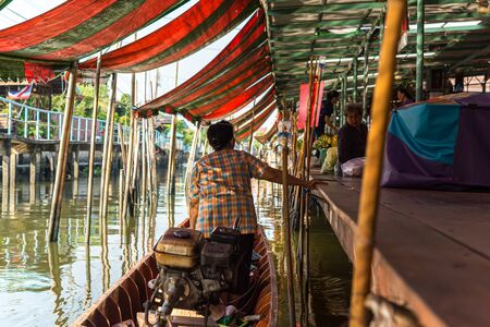 Nonthaburi , Thailand - March 11, 2019 : Wat Takien Floating Market every morning boat venders will cramp to Floating Market to sell product from plantations that varies from fruits to vegetables.