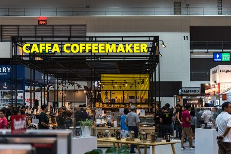 Bangkok, Thailand - March 16, 2019 : Unidentified coffee shop and barista showing coffee maker for roasting of coffee beans for sale and show to customers in the coffee and food exhibition show event.