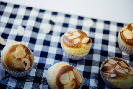 Cupcake or Sponge Cake is a cake based on flour , sugar, butter and eggs, and is sometimes leavened with baking powder topped with almond at Thai street food market or bakery dessert restaurant Imagens