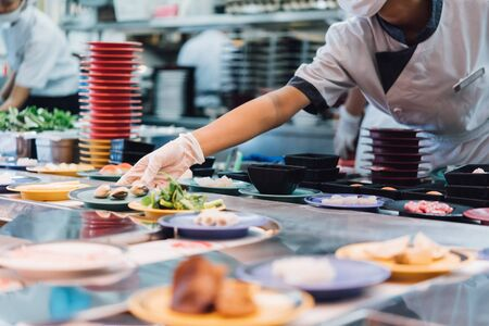 Bangkok, Thailand - May 18, 2019 : Unidentified chef cooking a food in the Japan food restaurant sushi conveyor or belt buffet for customer service in Thailand