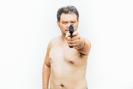 Asian man 40s fat body with beard chest and abdomen nude holding a gun or handgun aiming weapon for shot to target on white background Reklamní fotografie