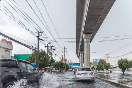 Samut Prakan, Thailand - October 5, 2019 : Water flood in Samut Prakan Province problem with the manhole overflow in drainage system it full from garbage when rain storm. Editöryel