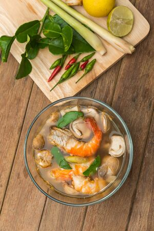 Hot and sour seafood soup (Tom Yum) for sale at Thai street food market or restaurant in Thailand