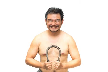 Asian man 40s fat body from obesity and diabetes tired effort exercise by use Arm Chest Strength Training Spring Power Twister Bar Exercise equipment for healthy and build muscle Stock Photo